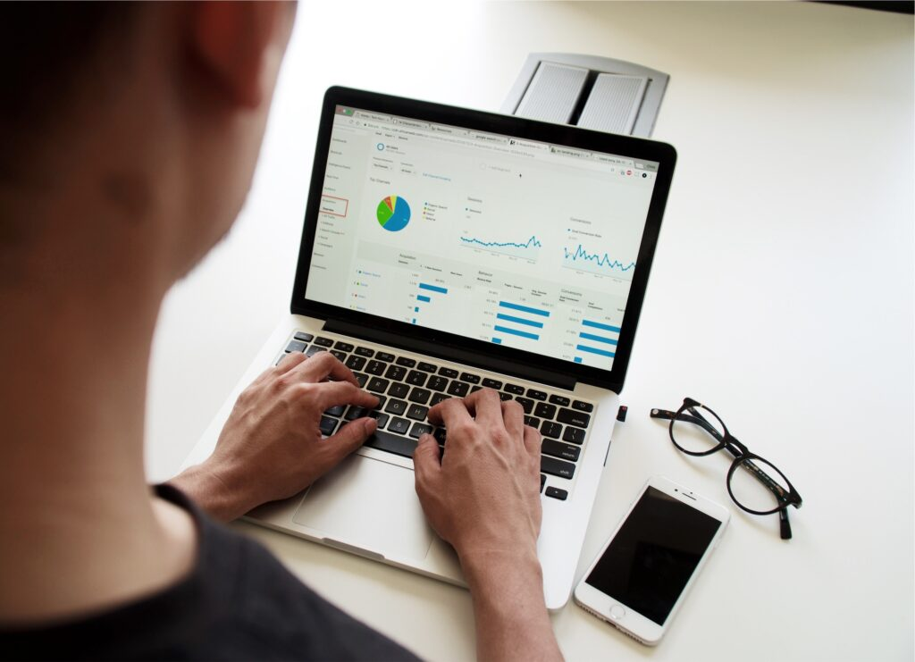 Man using a Macbook to analyse data